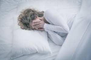picture of depressed woman sleeping all day